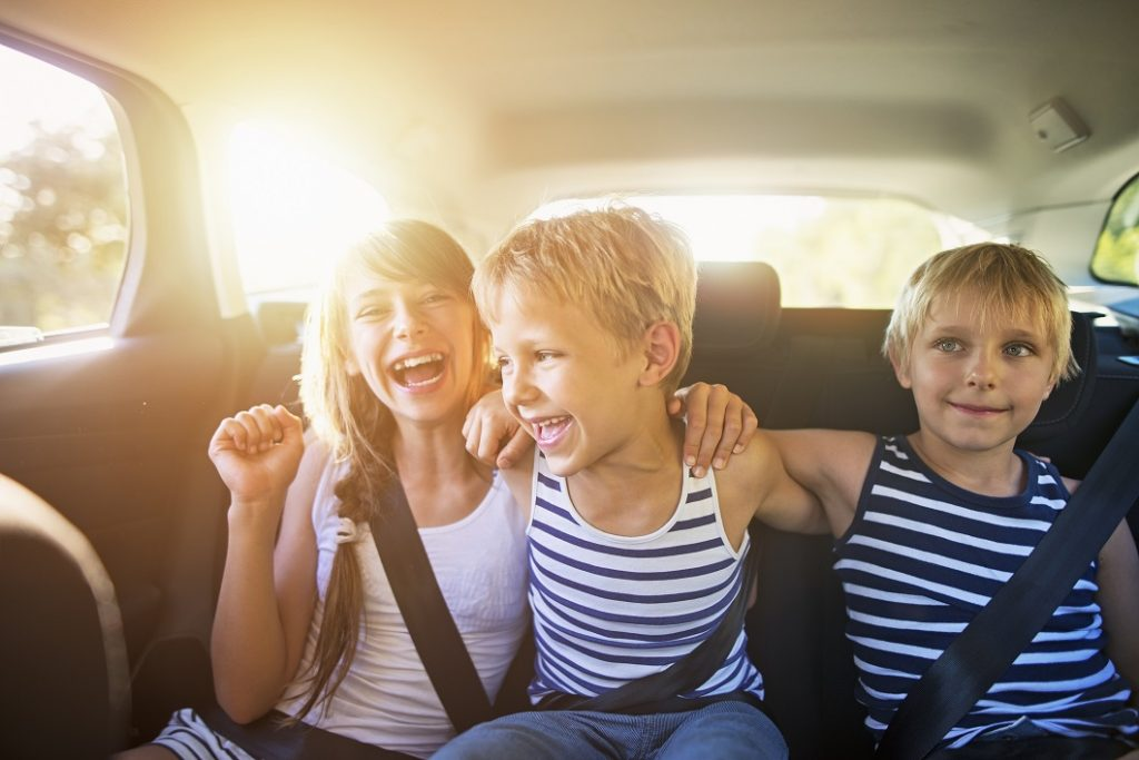 Kids having fun in car on a road trip